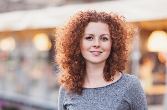 Smiling young woman with curly hair