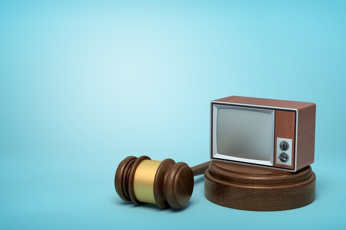 TV on a stand next to a gavel.