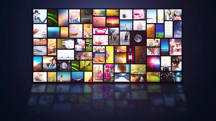 Digital screens against a black background.