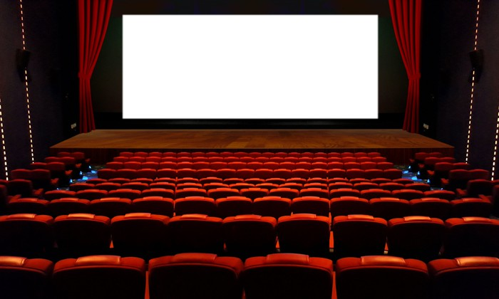 empty movie theater with blank white screen