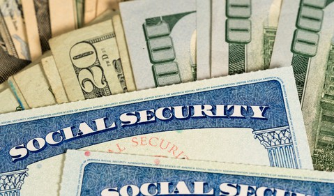 social security cards with hundred dollar bills