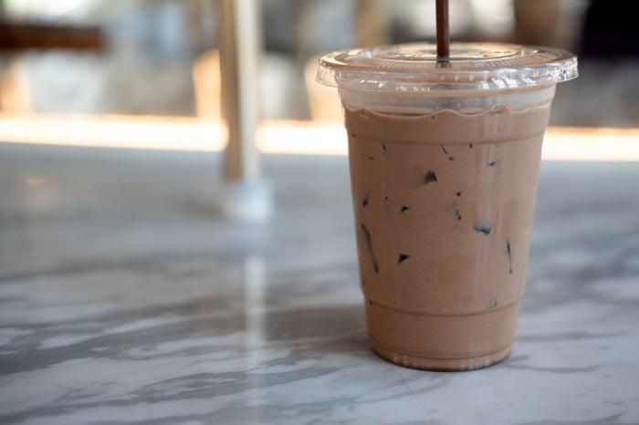 An iced coffee drink on a table.