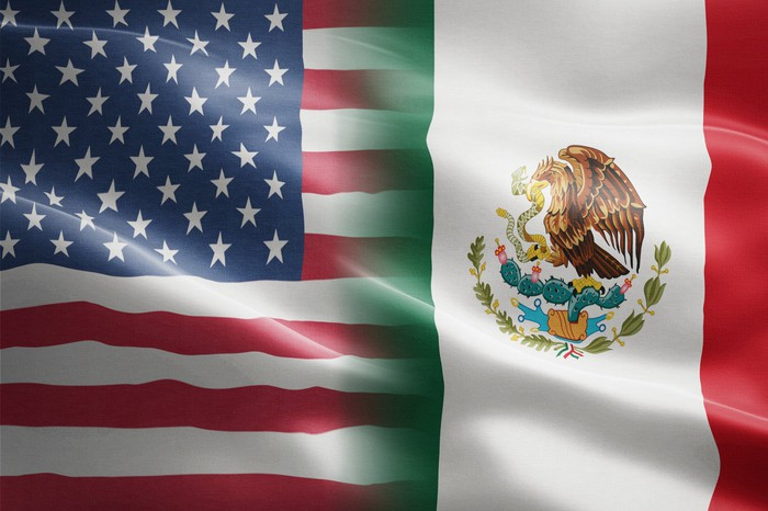 U.S. and Mexico flags together.