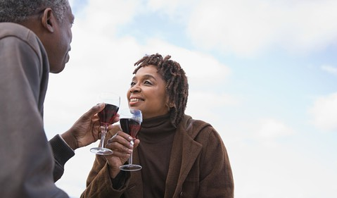 mature senior couple drinking wine toasting celebrating POC