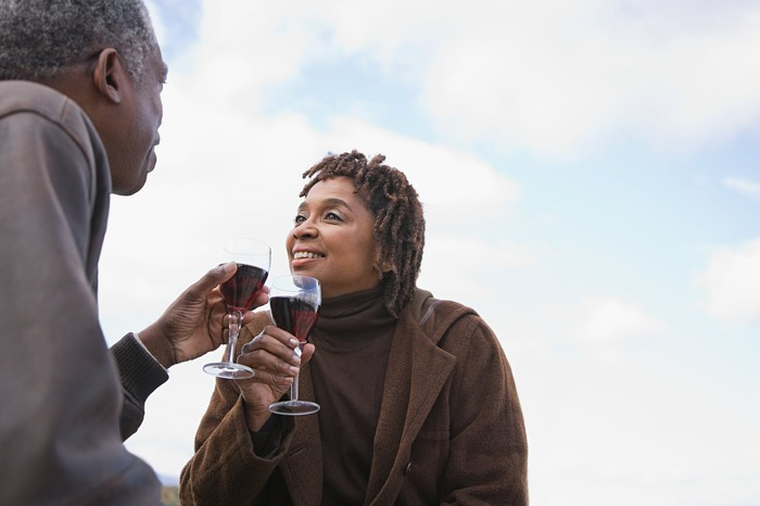 Older couple drinking wine together outside