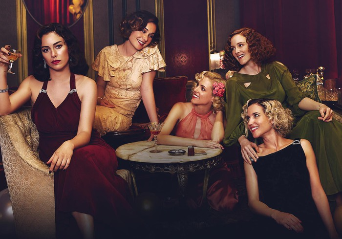 """The five main actresses from """"Las Chicas de Cable"""" or Cable Girls on Netflix celebrating in a lounge."""