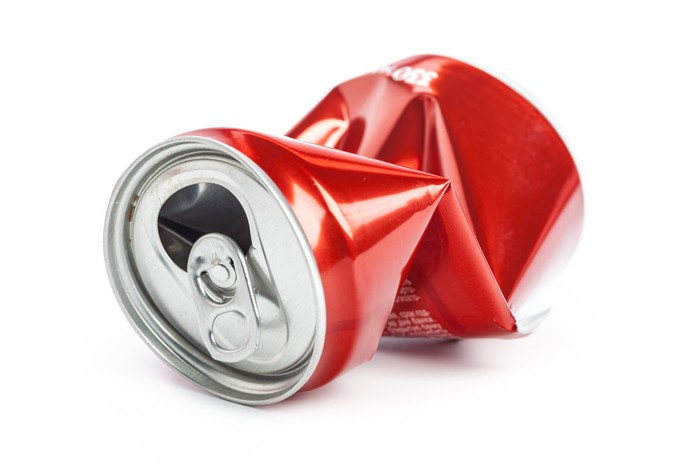 Crushed empty soft drink can