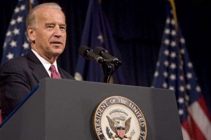 Joe Biden speaking behind a podium.