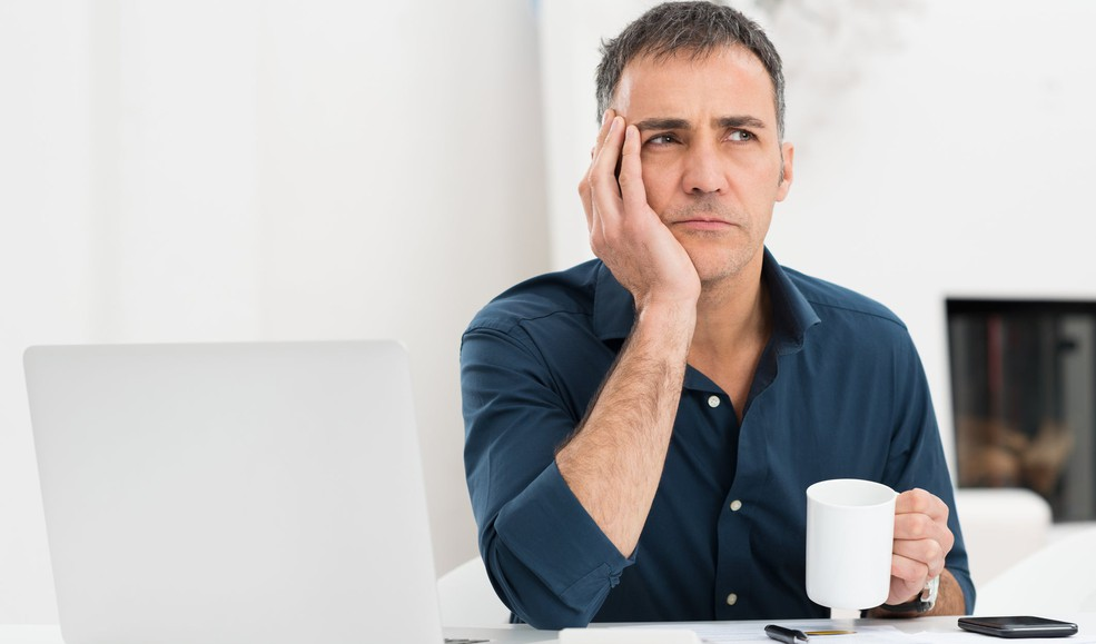 worried man at desk_GettyImages-466203577