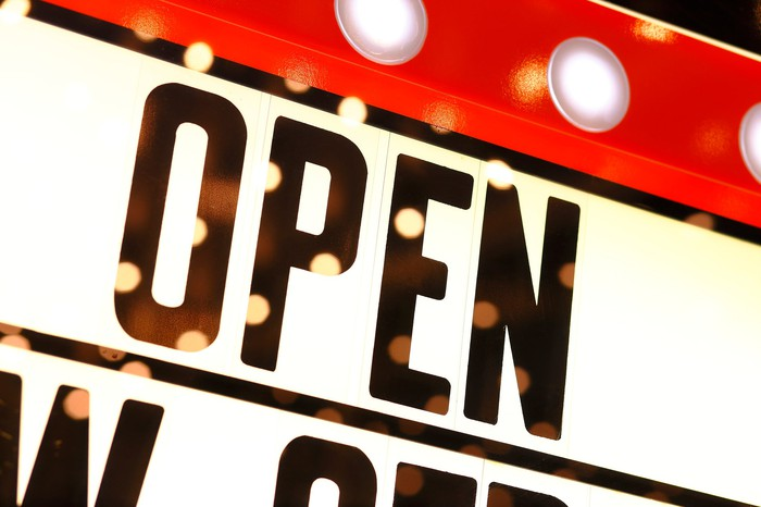 """A movie marquee with the word """"Open."""""""