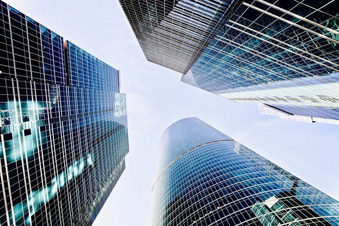 A group of skyscrapers, seen from below.