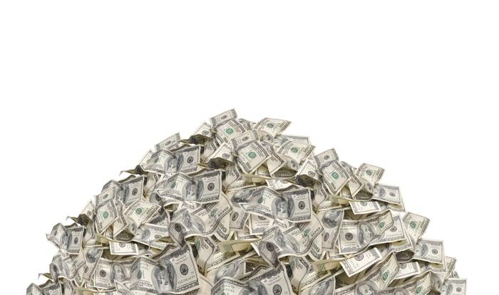 Pile of American one hundred dollar bills on white background.