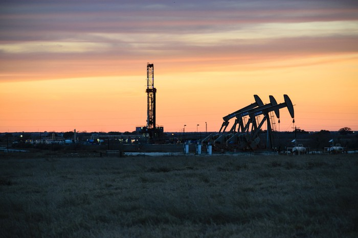 oil and gas drilling in Texas' Permian Basin at sunset