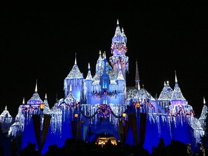 Disneyland's Sleeping Beauty Castle, lit up at night.
