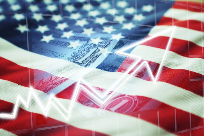 American flag with watermark of dollar bill and growth arrow.