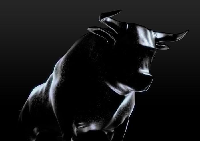 A shadowy silver bull emerging from a dark background.