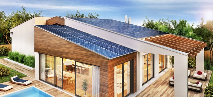 A drawing of a modern house with solar panels on the roof.