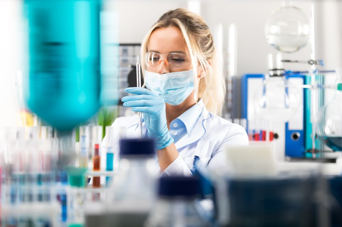A scientist prepares her experiment in the laboratory.