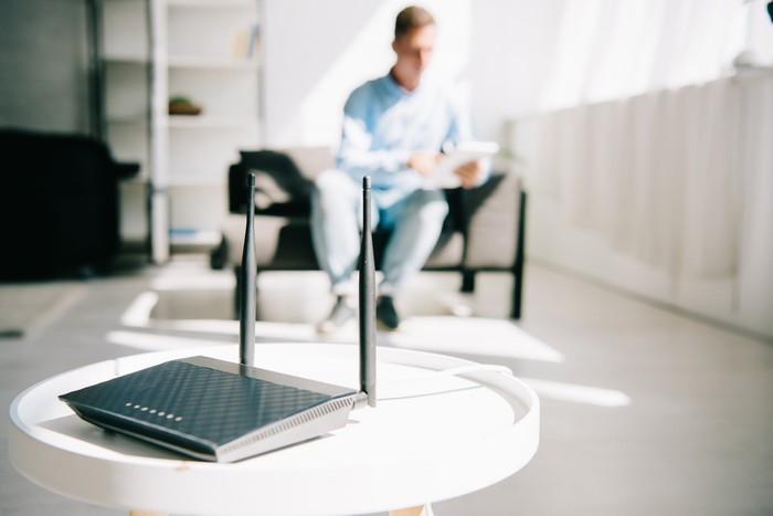 Man sitting near a wireless router