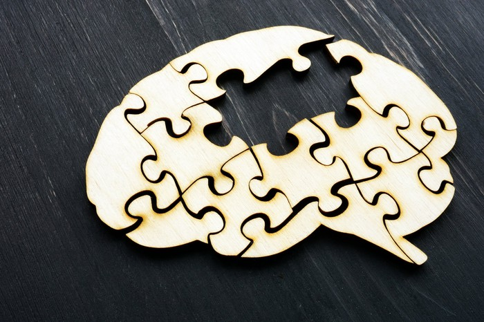 Puzzle of a human brain with a missing piece.