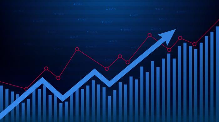 A blue arrow rising on top of  a bar chart