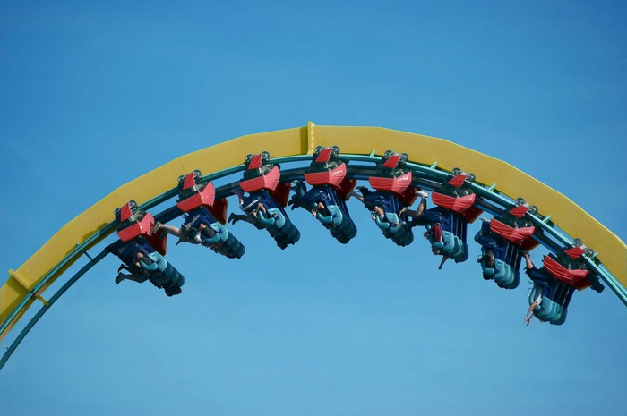 Roller coaster with people upside down.