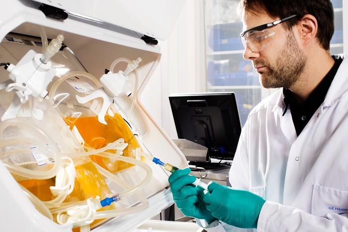 A scientist working on a lab sample.