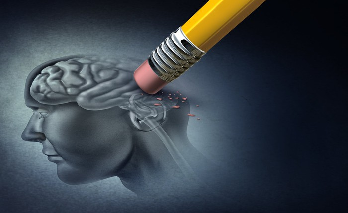 a drawing of a person and their brain with a pencil erasing the brain