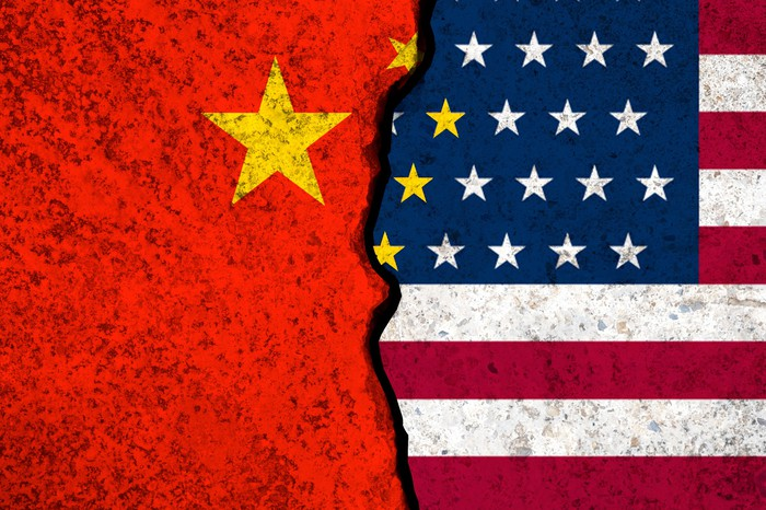 Half of China flag, and half of U.S. flag, with a huge crack in between them