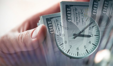 Cash Money Bills Clock Invest Retire Long-Term Getty