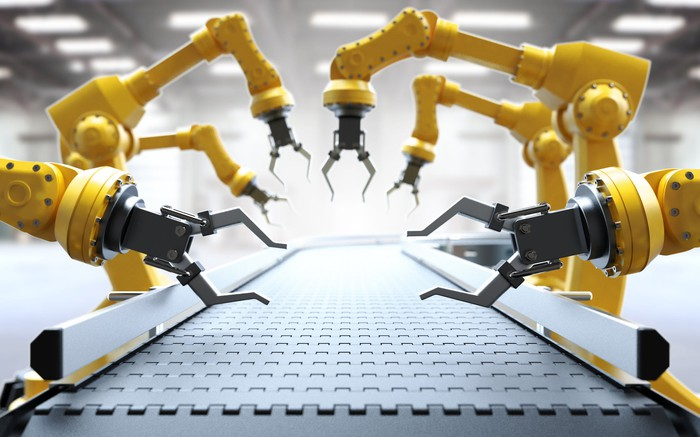 Robotic arms in an assembly line.