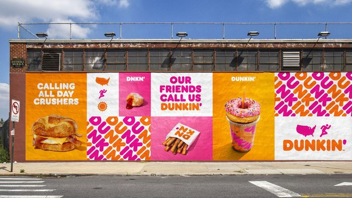 dunkin' donuts, coffee and food displayed with brand on side of building