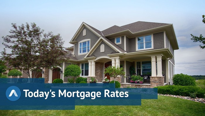 Large, well-kept home in the suburbs with Today's Mortgage Rates graphic.