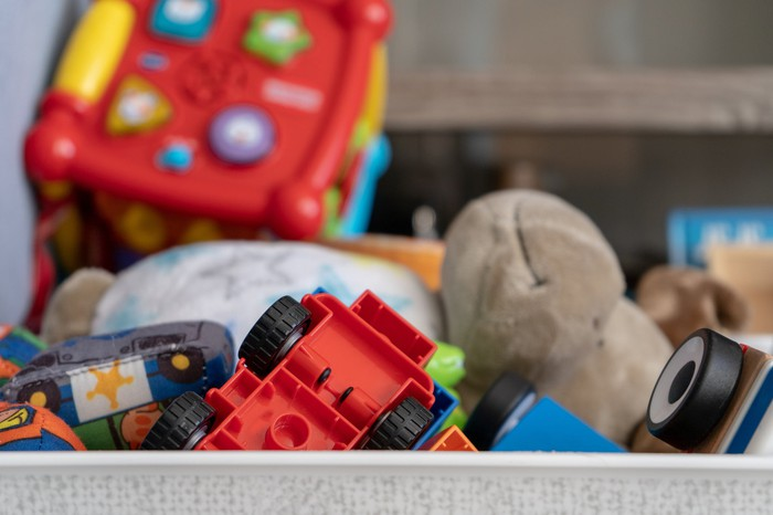 Various toys, including a stuffed animal and car.