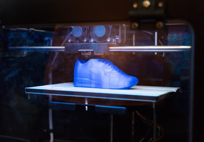 A 3D printer creating a shoe.
