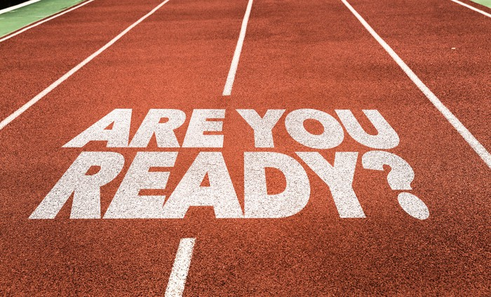 The question are you ready is printed on a running track.