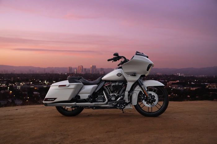 White motorcycle in front of Los Angeles skyline