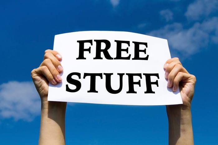 "Man holding a ""free stuff"" sign."