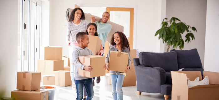 A family unpacking boxes in their new house.