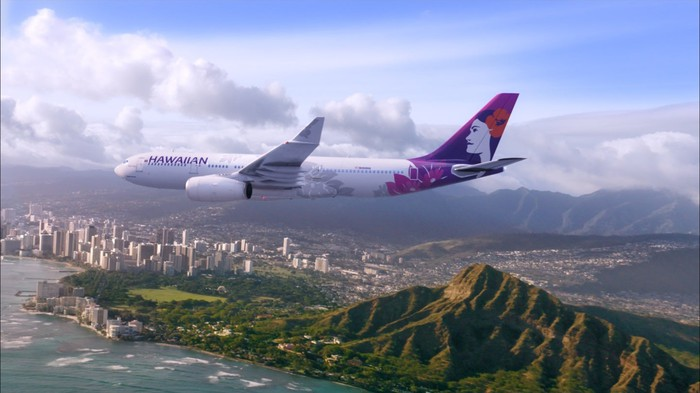 A Hawaiian Airlines jet over Diamond Head.