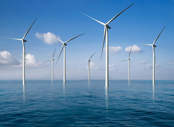 Windmills in shallow water.