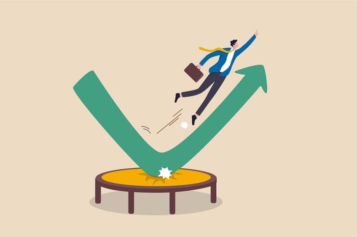 A cartoon drawing of a man jumping off a trampoline over an upward pointing green arrow.