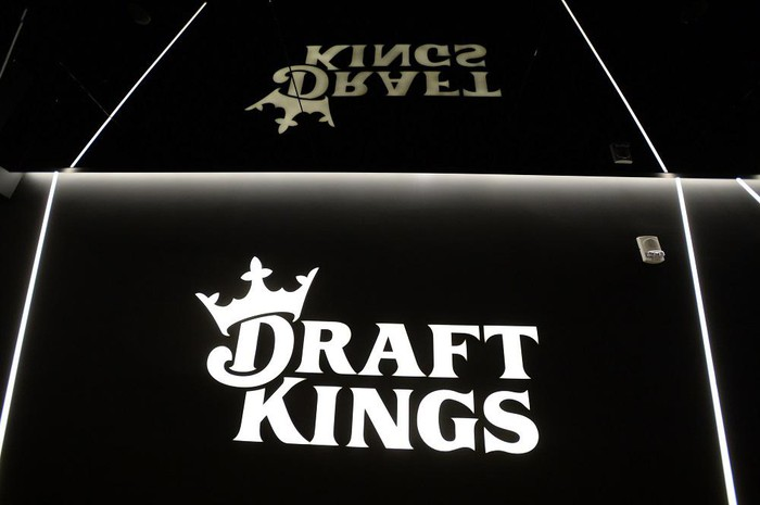 The DraftKings logo is displayed at the entrance  to its headquarters.
