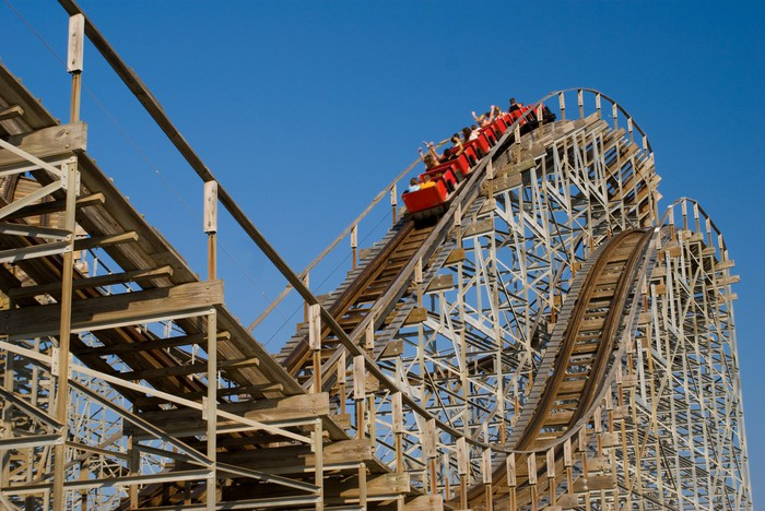 Roller coaster with ride going up hill.