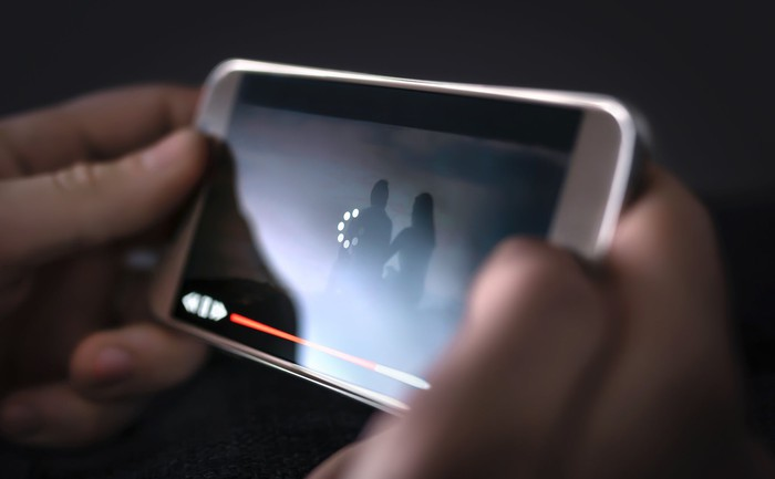 Person streaming video on a smartphone.