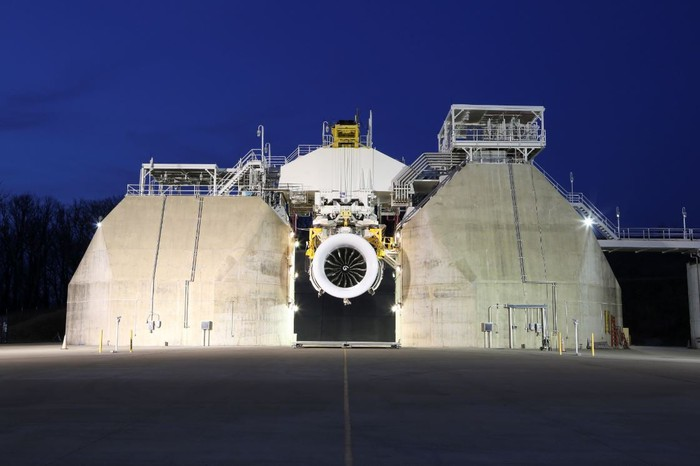 A GE jet engine in a test cell.