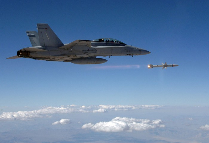 A warplane firing a Northrop Grumman guided missile.
