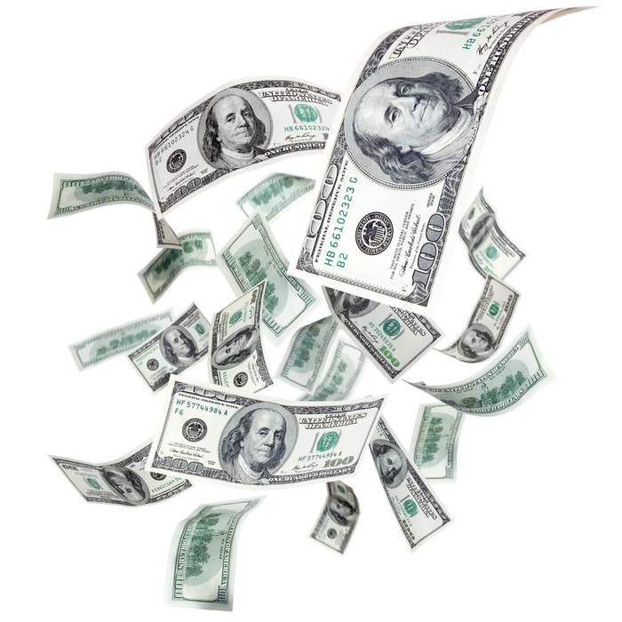 Hundred dollar bills raining down.