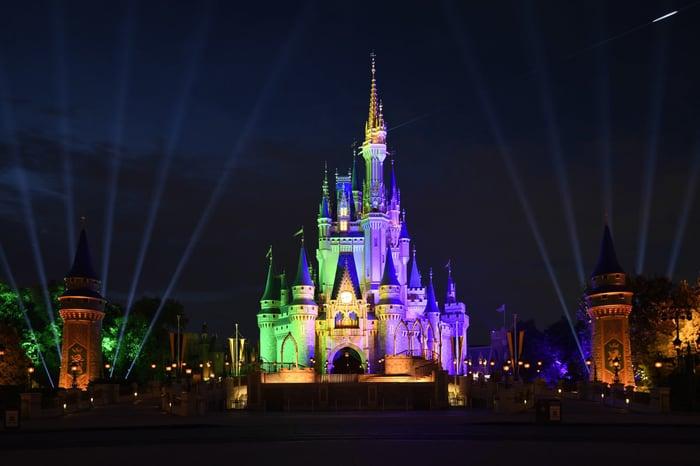 Disney castle lit up at night