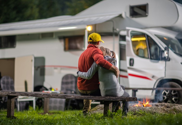 father and daughter camping with RV
